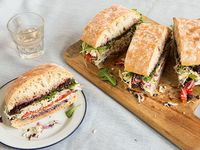 Roast Chicken Pan Bagnat with Olive Tapenade and Goat Cheese