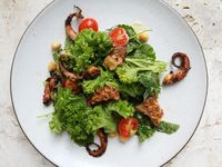 Grilled Octopus with Chickpeas, Cherry Tomatoes, and Anchovy Vinaigrette