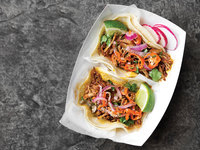 Yucatán-Style Shredded Pork Tacos with Achiote (Cochinita Pibil Tacos)