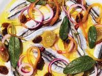 Marinated Anchovies with Candied Citrus, Pickled Raisins, and Chile