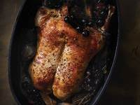The Winemaker's Roast Duck with Shallots and Concord Grapes