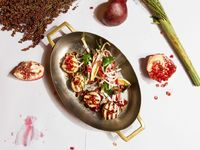 Grilled Scallops with Pomegranate Brown Butter and Toasted Hazelnuts