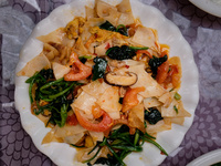 Stir-Fried Chinese Rice Cakes with Pork Belly, Tomatoes, and Spinach (Dajiujia)